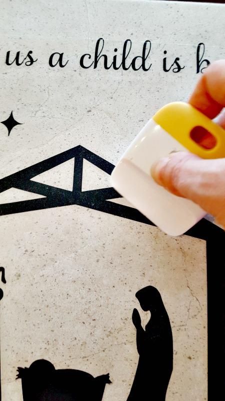 applying vinyl to large tile for Christmas decor