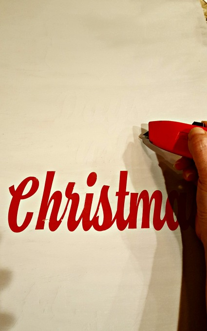 peeling stencil off christmas countdown sign