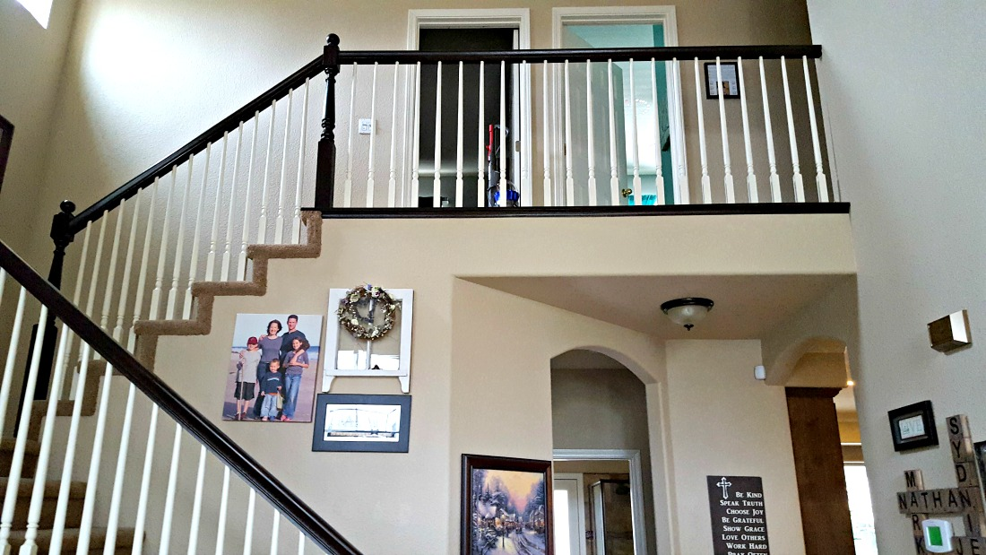 staircase refinishing with brown banister and white spindles