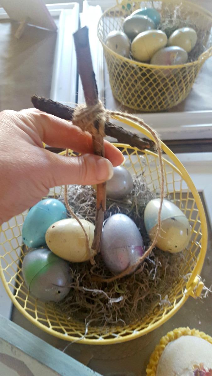 tying wood cross to easter basket