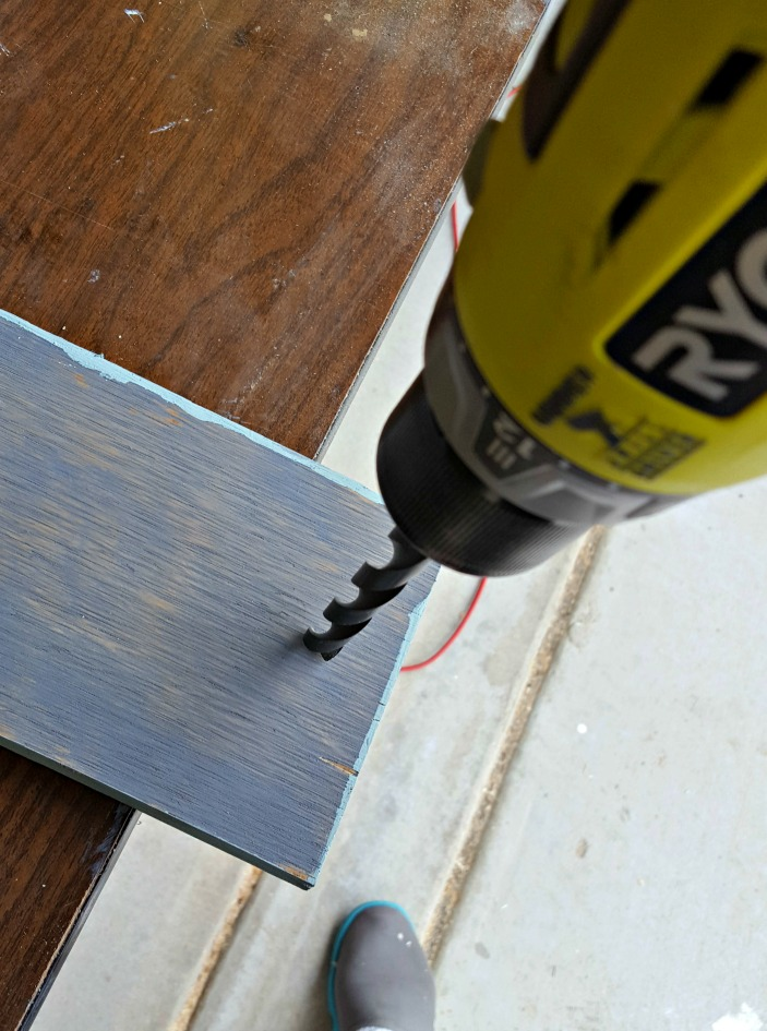 drilling hole into wood sign