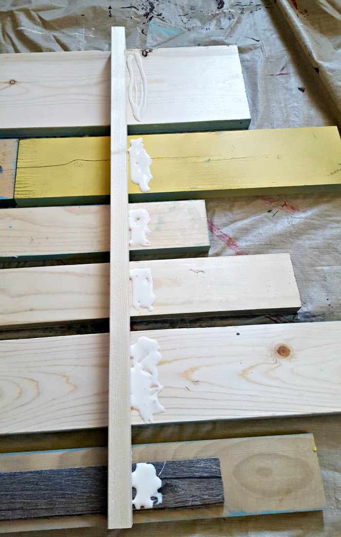 gluing boards on the back of a patio rules sign