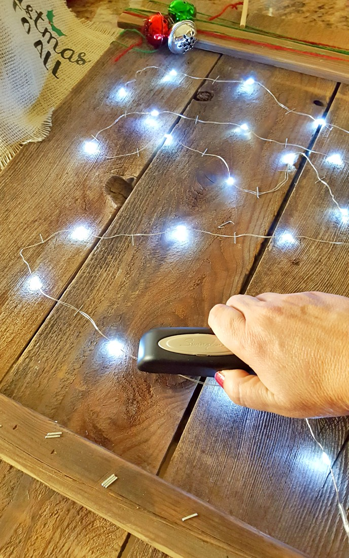 adding lights to christmas wood sign