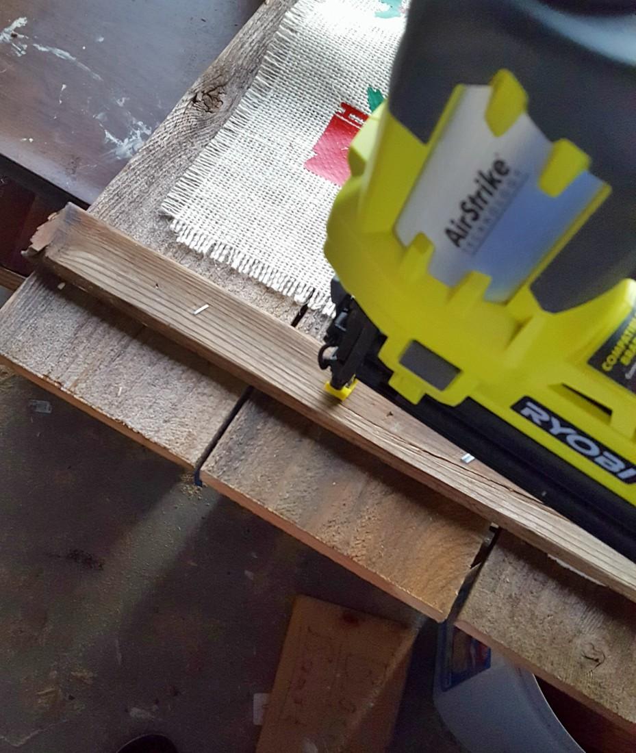 using nail gun on wood Christmas sign