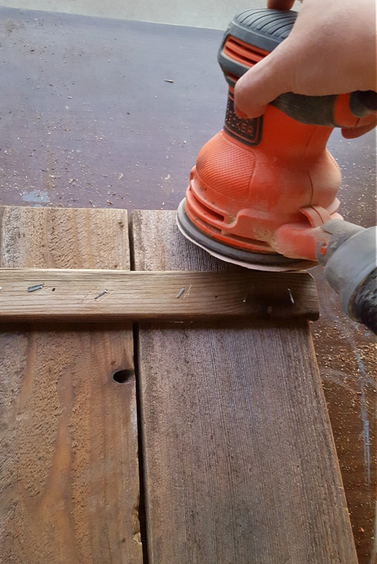 sanding old fence boards
