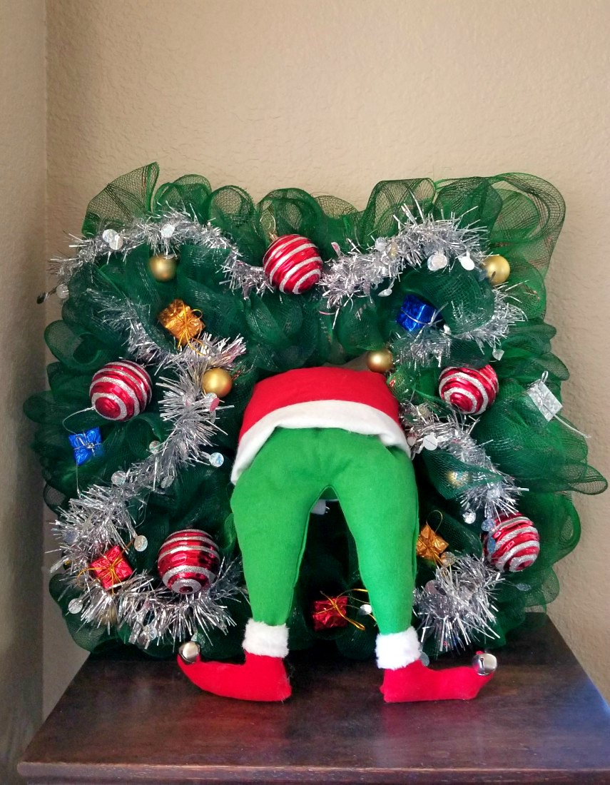 grinch wreath with legs coming out of tree