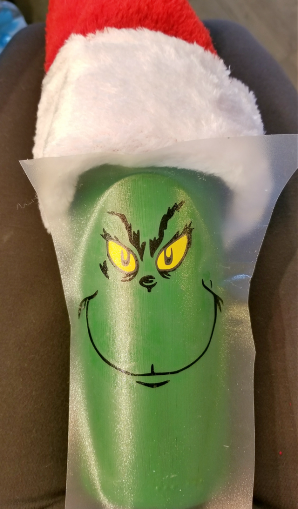 grinch decorated wine bottle