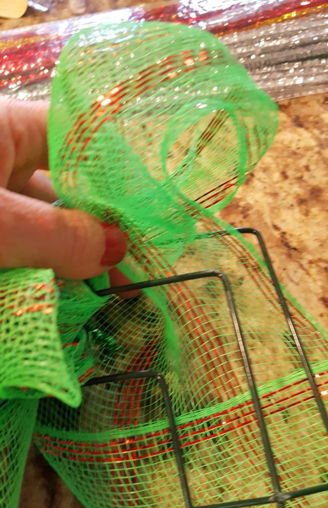 adding mesh ribbon to a wreath