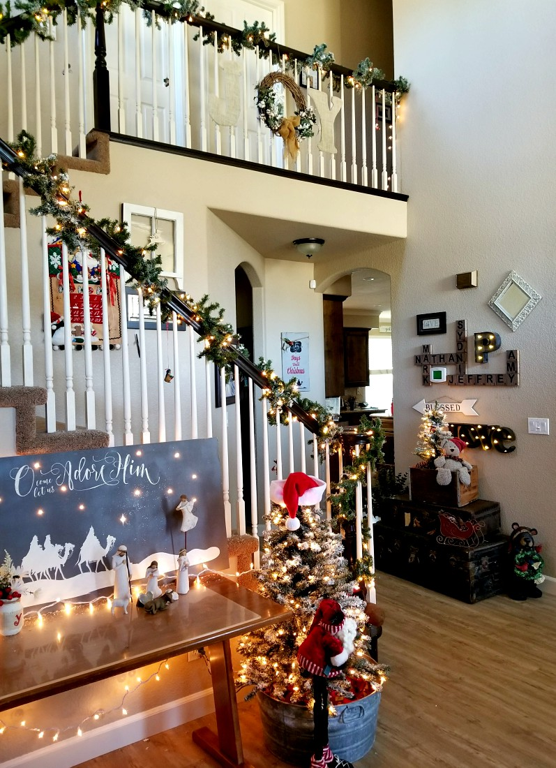 lighted Christmas banister with greenery