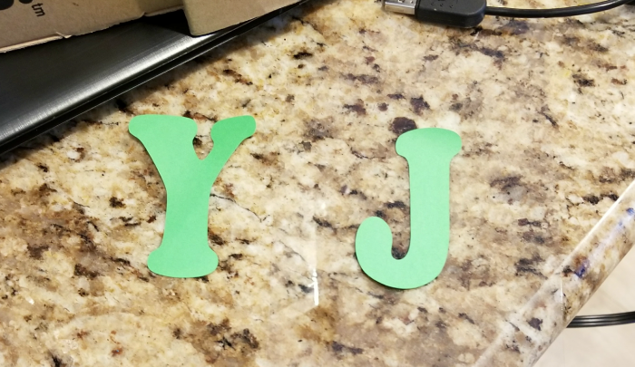 making DIY Joy sign staircase decor