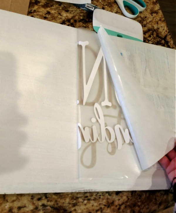 applying vinyl to sign with transfer tape