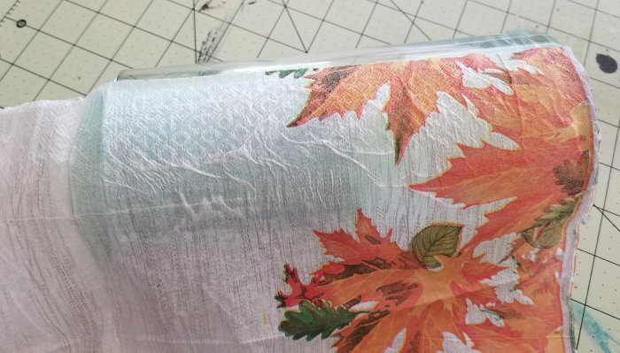applying napkin on mod podge and glass