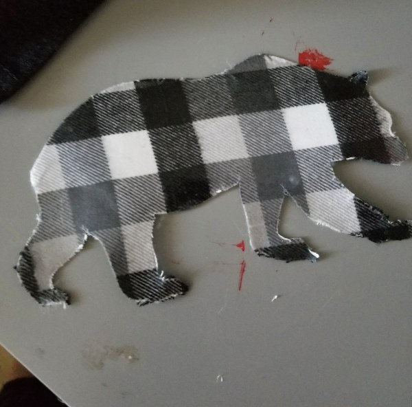 bear svg cut out of buffalo check fabric