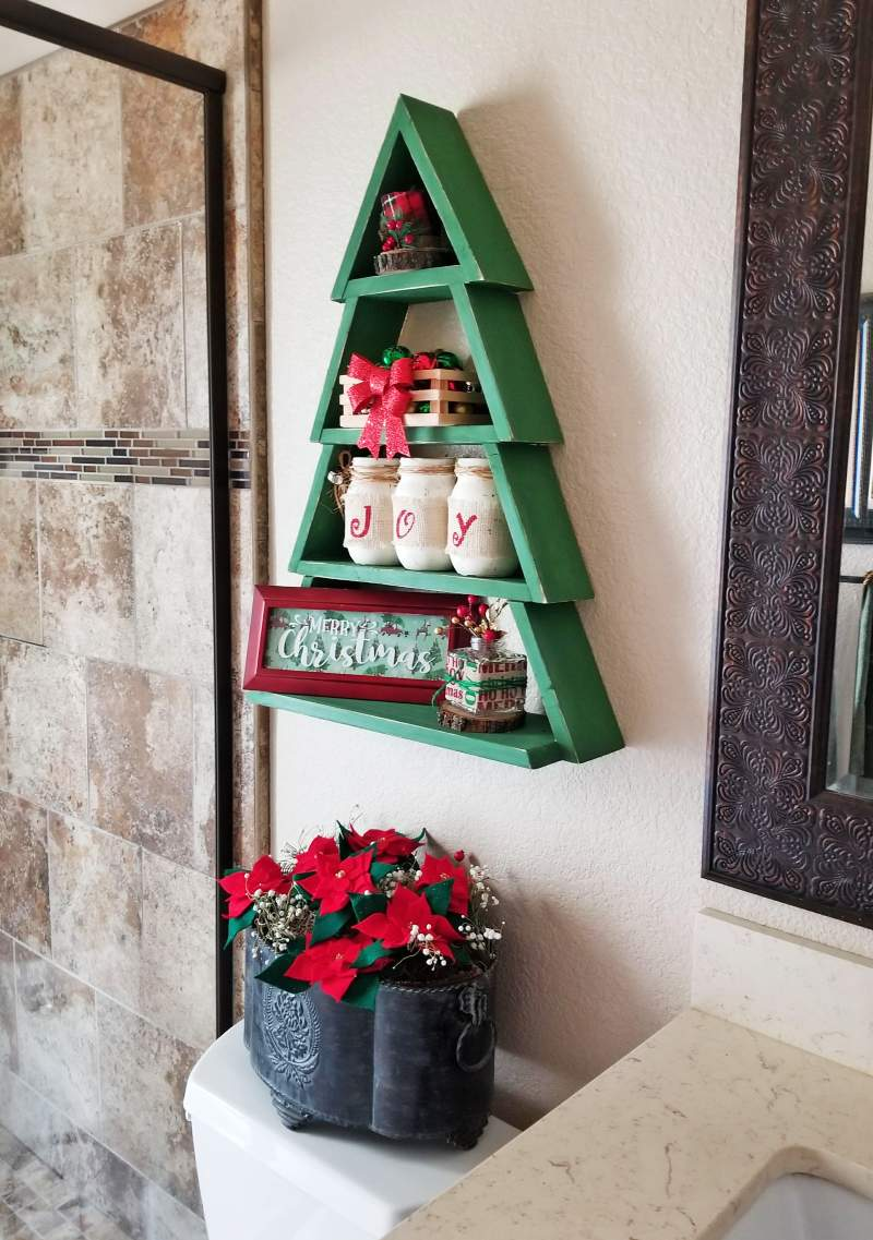wooden christmas tree shelf in bathroom