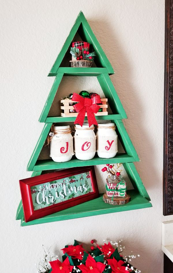 wooden christmas tree shelf with decorations