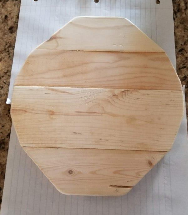 cut out wooden pumpkin