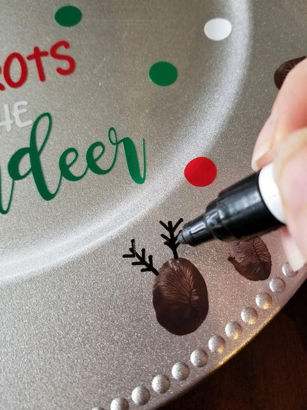 painting reindeer antlers on thumbprint