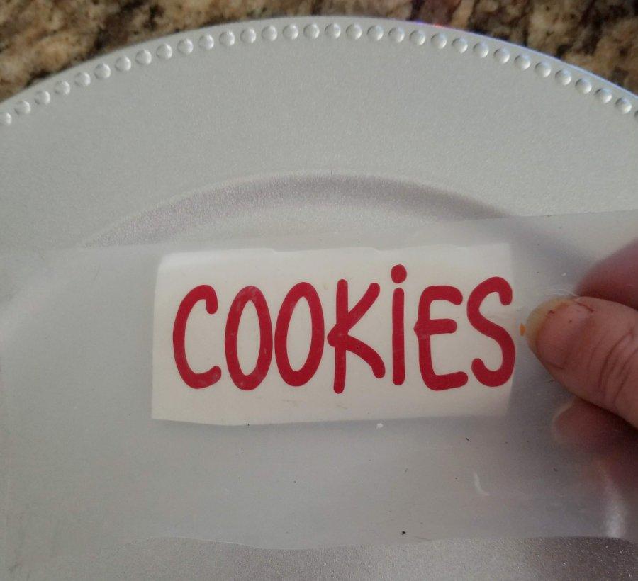 applying cookies vinyl decal to plate