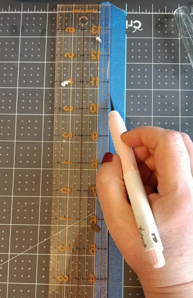 cutting painter's tape in half