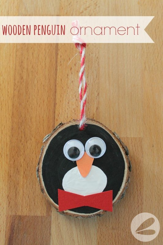 Wooden penguin ornament christmas craft tutorial.