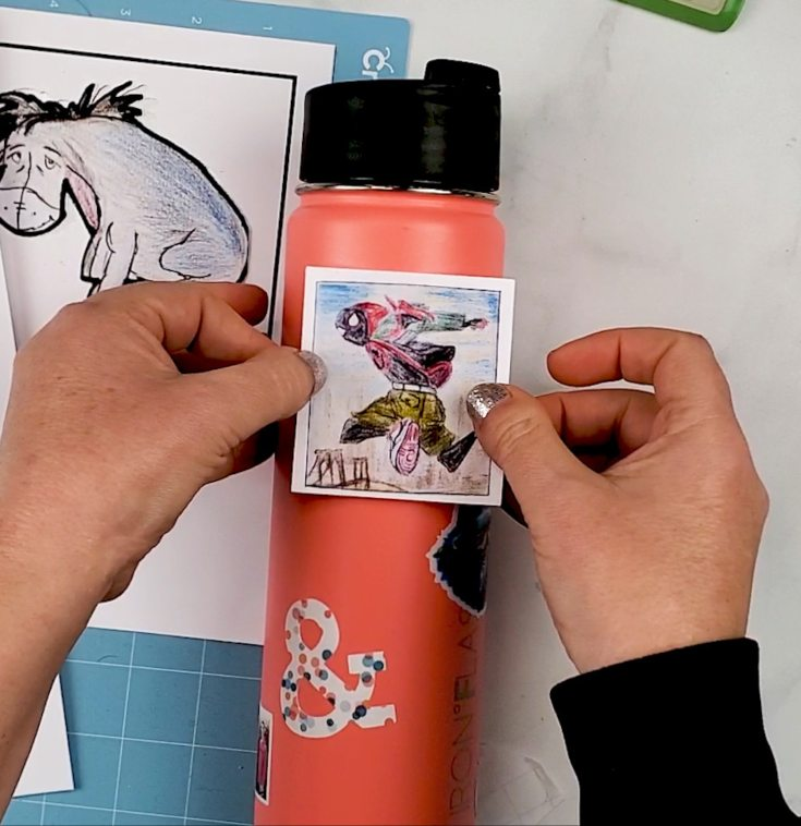 applying stickers to tumbler