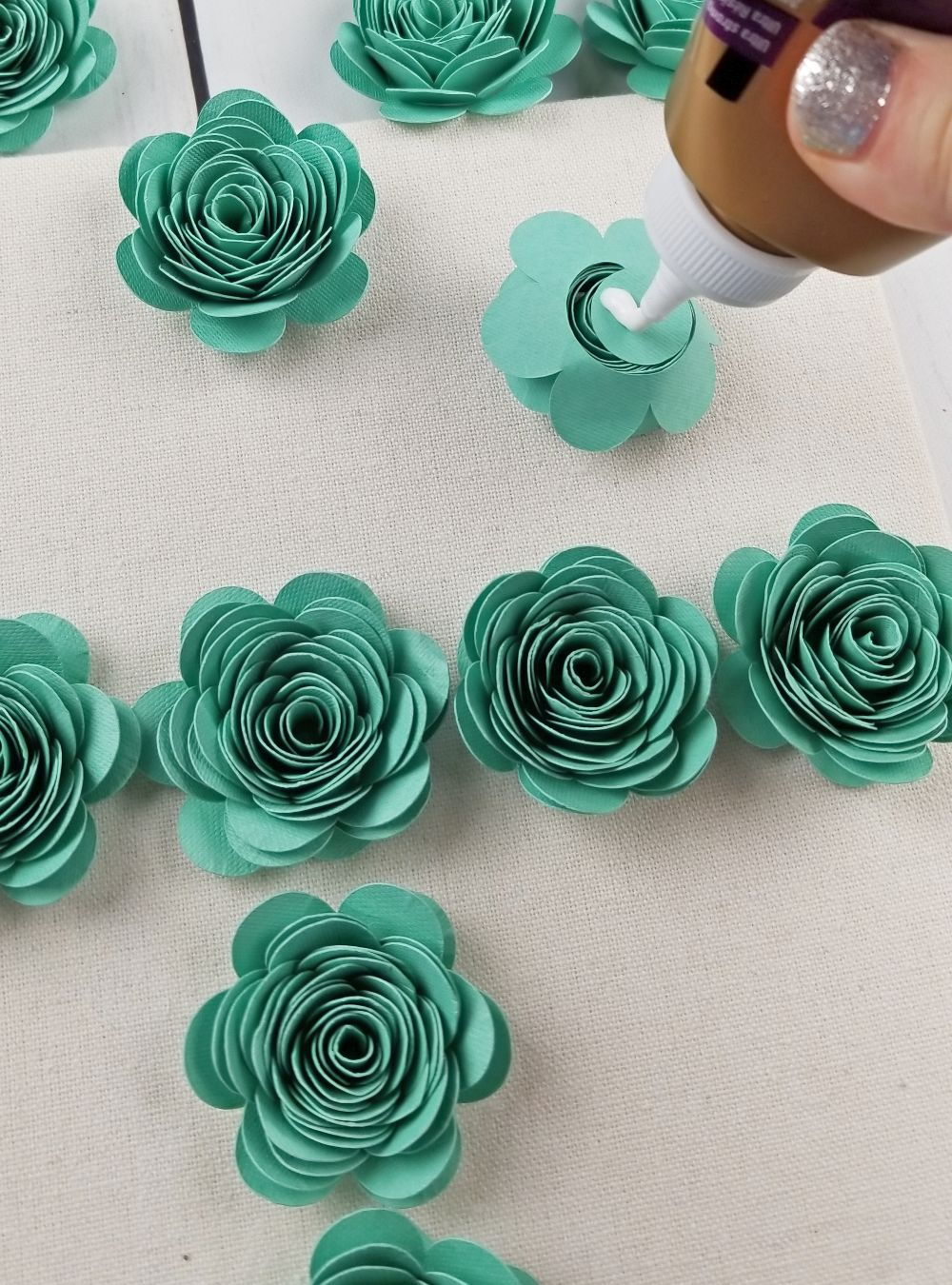gluing paper flowers in shadow box