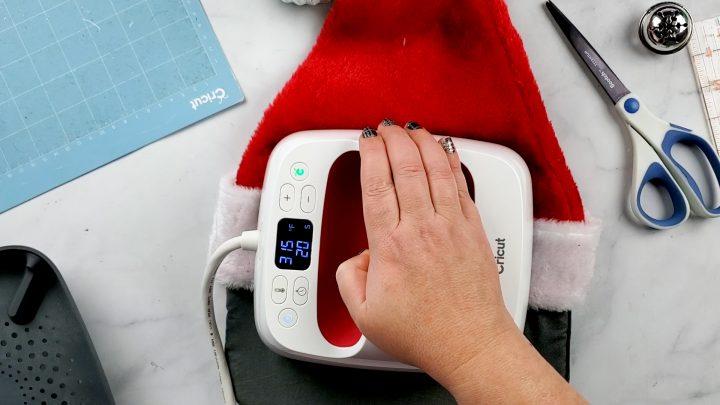 applying htv to santa hat