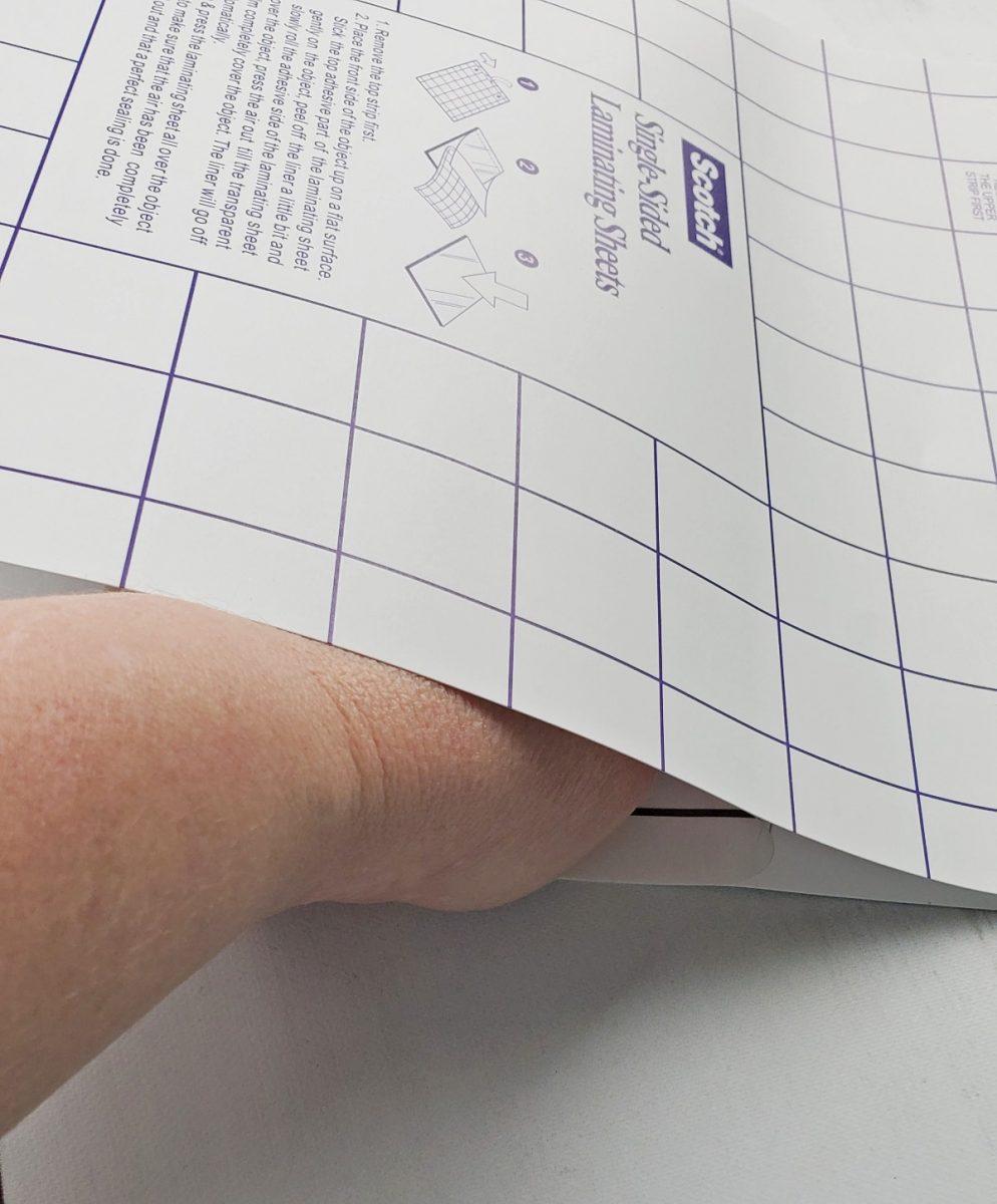 smoothing laminating sheets down