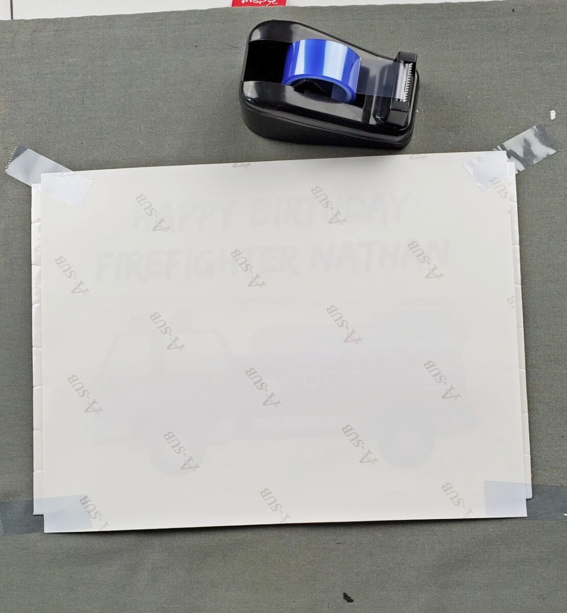 taping sublimation photo to puzzle