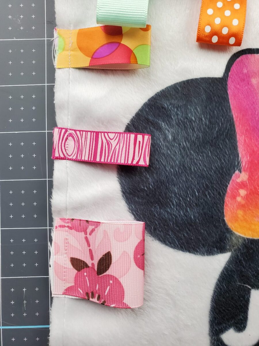 sewed on tags to minky