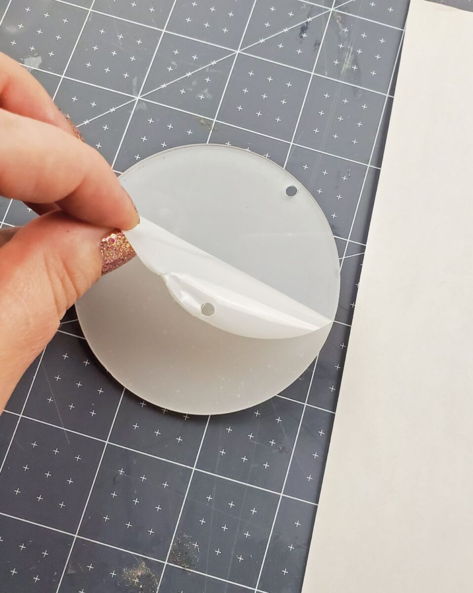 peeling film off acrylic ornament